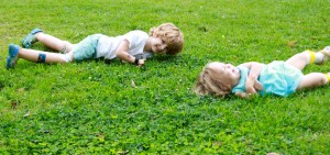 kids rolling down hill