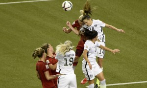 Jun 30, 2015; Montreal, Quebec, CAN; United States midfielder Morgan Brian (14) and Germany forward Alexandra Popp (18) collide attempting a header during the first half of the semifinals of the FIFA 2015 Women's World Cup at Olympic Stadium. Brian and Popp were injured on the play. Mandatory Credit: Eric Bolte-USA TODAY Sports ORG XMIT: USATSI-230278 ORIG FILE ID:  20150630_ajw_bb5_045.jpg